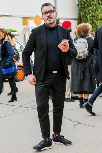 How to Wear a Black Long Sleeve Shirt For Men: A black long sleeve shirt and black chinos? This is an easy-to-achieve look that any man can rock on a daily basis. To give your overall look a more laid-back aesthetic, why not add black athletic shoes to the mix?