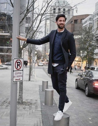 How to Wear a Navy Crew-neck Sweater For Men: This casual pairing of a navy crew-neck sweater and navy chinos can take on different forms depending on the way you style it out. Balance out your getup with more laid-back footwear, like this pair of white canvas low top sneakers.