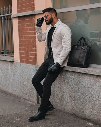 How to Wear Black Jeans For Men: Pairing a beige blazer and black jeans is a guaranteed way to infuse masculine sophistication into your current routine. Feeling venturesome today? Class up this look with black leather chelsea boots. Surely a good choice if we're talking style for 30-something gents.