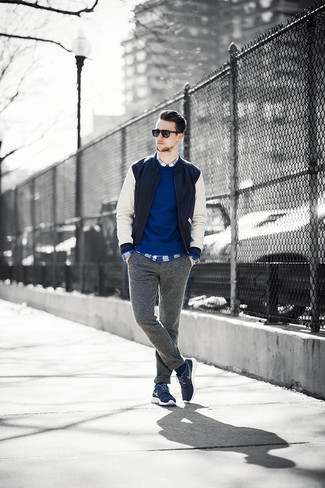 How to wear: grey wool chinos, blue plaid long sleeve shirt, blue crew-neck sweater, black and white leather bomber jacket