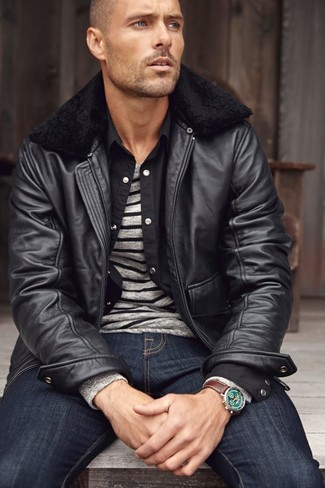 How to wear: navy jeans, black long sleeve shirt, grey horizontal striped crew-neck sweater, black leather bomber jacket
