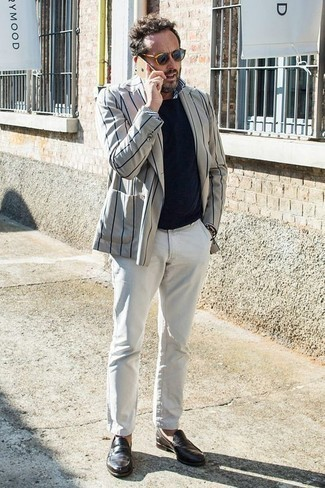 Men's Looks & Outfits: What To Wear In 2020: This combo of a grey vertical striped double breasted blazer and white chinos looks elegant, but in a modern way. Go ahead and introduce a pair of dark brown leather loafers to the equation for an added dose of style.