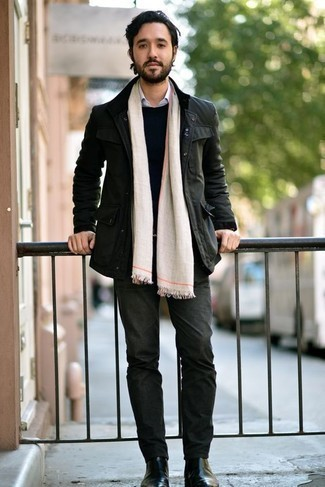 How to Wear a Black Crew-neck Sweater For Men: A black crew-neck sweater and dark green jeans are the kind of a fail-safe casual combination that you so desperately need when you have no time. To give this ensemble a dressier spin, why not complete this ensemble with a pair of black leather chelsea boots?