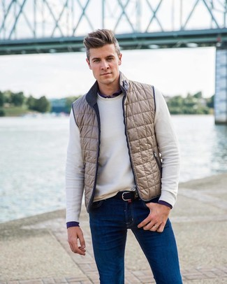 How to wear: blue jeans, navy long sleeve shirt, white crew-neck sweater, beige gilet
