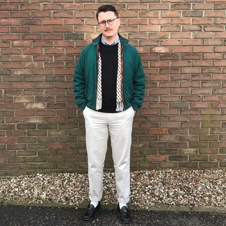 How to wear: beige chinos, light blue long sleeve shirt, black crew-neck sweater, dark green harrington jacket
