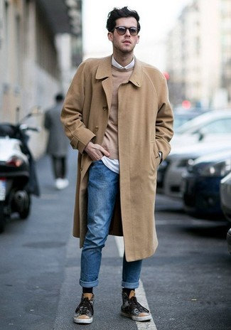 How to wear: blue jeans, white long sleeve shirt, tan crew-neck sweater, camel overcoat