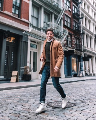 How to wear: blue jeans, white long sleeve shirt, charcoal crew-neck sweater, camel overcoat