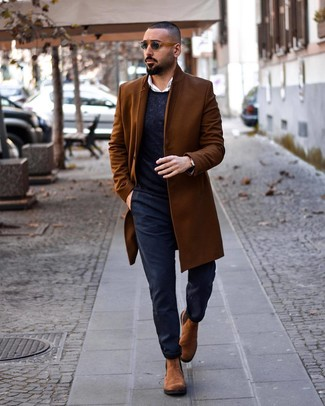 How to Wear a Brown Overcoat: This combination of a brown overcoat and navy chinos is ideal for elegant situations. Boost the formality of this getup a bit with a pair of brown suede chelsea boots.