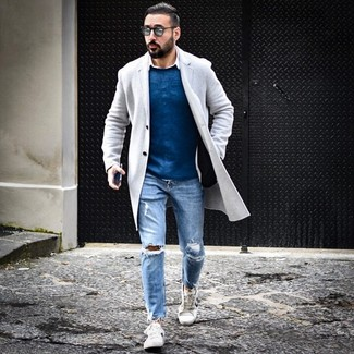 How to wear: light blue ripped jeans, white long sleeve shirt, blue crew-neck sweater, grey overcoat