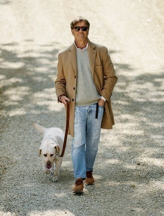 Men's Looks & Outfits: What To Wear Casually: A camel overcoat and light blue ripped jeans will add serious style to your current off-duty rotation. Bring a more laid-back spin to by rounding off with a pair of brown athletic shoes.