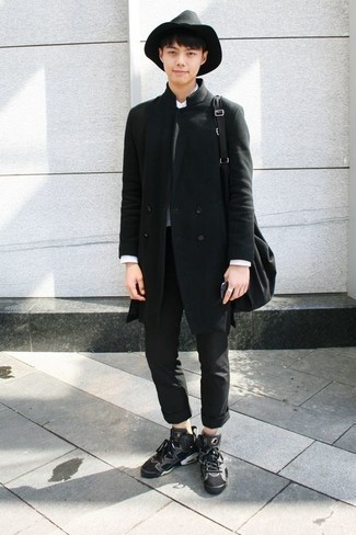 How to Wear a Charcoal Crew-neck Sweater For Men: A charcoal crew-neck sweater and black chinos paired together are a perfect match. Inject an easy-going feel into this getup by slipping into a pair of charcoal canvas high top sneakers.