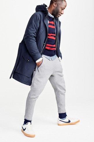 How to wear: grey sweatpants, light blue vertical striped long sleeve shirt, navy and red horizontal striped crew-neck sweater, navy parka