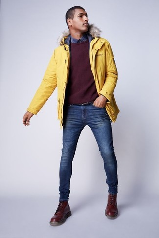 How to wear: blue skinny jeans, navy plaid long sleeve shirt, burgundy crew-neck sweater, yellow parka