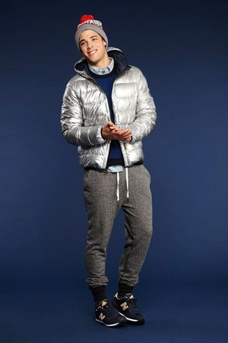How to wear: grey sweatpants, light blue long sleeve shirt, navy crew-neck sweater, silver puffer jacket