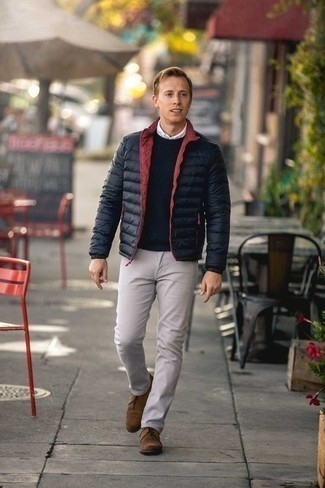 Men's Looks & Outfits: What To Wear In 2020: A black lightweight puffer jacket and beige chinos are among the crucial items in any modern man's classic and casual closet. All you need now is a good pair of tan suede desert boots to complete your getup.