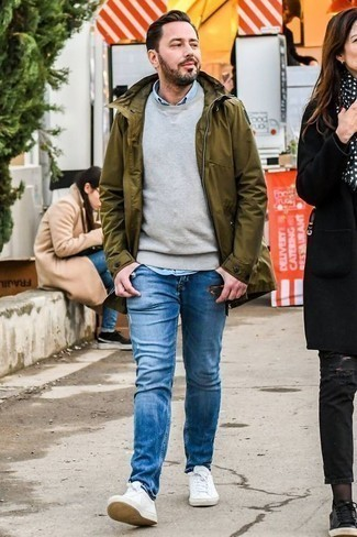 How to Wear a Light Blue Chambray Long Sleeve Shirt For Men: Pairing a light blue chambray long sleeve shirt with blue ripped jeans is an on-point pick for a casual outfit. Serve a little outfit-mixing magic by rounding off with a pair of white leather low top sneakers.