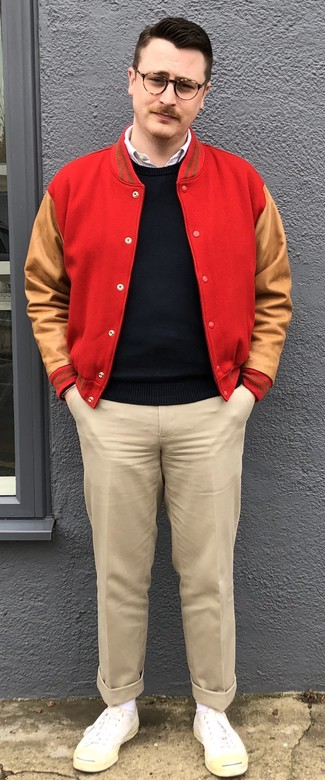 How to wear: beige chinos, white long sleeve shirt, black crew-neck sweater, red varsity jacket