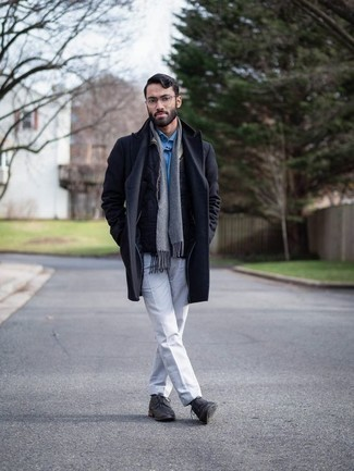 Men's Looks & Outfits: What To Wear In Winter: Combining a navy overcoat and white dress pants will create a sharp, masculine silhouette. Kick up your whole outfit by sporting a pair of charcoal leather casual boots. In the colder months, when warmth is the priority, it can be easy to settle for a less-than-stylish outfit. But this outfit is a stark illustration that you can actually stay toasty and remain equally stylish during the colder months.