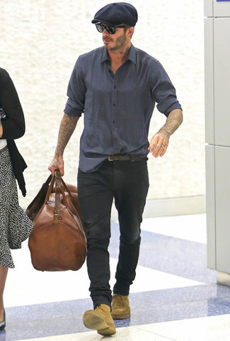 David Beckham wearing Navy Print Long Sleeve Shirt, Black Jeans, Tan Suede Casual Boots, Brown Leather Holdall