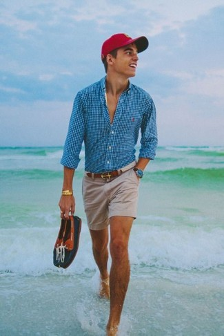 How to wear: aquamarine gingham long sleeve shirt, beige shorts, navy leather boat shoes, red baseball cap