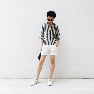 How to wear: white and navy vertical striped long sleeve shirt, white shorts, white canvas low top sneakers, black leather zip pouch