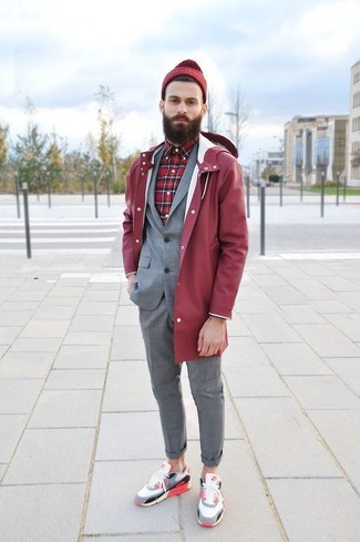 How to wear: multi colored low top sneakers, red plaid long sleeve shirt, grey suit, red raincoat