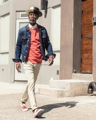 Men's Looks & Outfits: What To Wear In Warm Weather: Marrying a navy denim jacket with beige chinos is an on-point idea for a casually dapper ensemble. When in doubt as to what to wear when it comes to footwear, add red and white canvas slip-on sneakers to the mix.