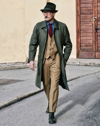 How to Wear a Burgundy Tie For Men: This combination of a dark green overcoat and a burgundy tie is perfect for dressier settings. Our favorite of a myriad of ways to finish this look is with a pair of dark green leather brogue boots.