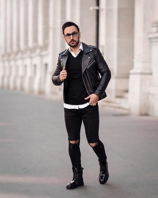 How to wear: black ripped skinny jeans, white long sleeve shirt, black v-neck sweater, black leather biker jacket