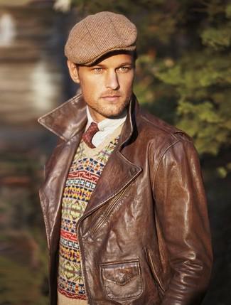 How to wear: brown plaid flat cap, white long sleeve shirt, beige fair isle v-neck sweater, brown leather biker jacket