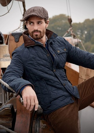 How to wear: dark brown corduroy jeans, navy plaid long sleeve shirt, navy v-neck sweater, navy quilted bomber jacket
