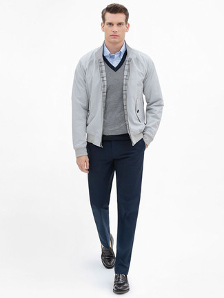How to Wear a Grey V-neck Sweater For Men: A grey v-neck sweater looks especially elegant when combined with navy dress pants for a look worthy of a complete gentleman. When it comes to shoes, introduce dark brown leather loafers to your getup.