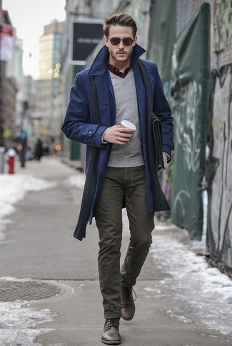 How to Wear a Grey V-neck Sweater For Men: This combo of a grey v-neck sweater and olive jeans is on the casual side yet it's also stylish and really dapper. For something more on the sophisticated end to complete this ensemble, complete your ensemble with dark brown leather casual boots.