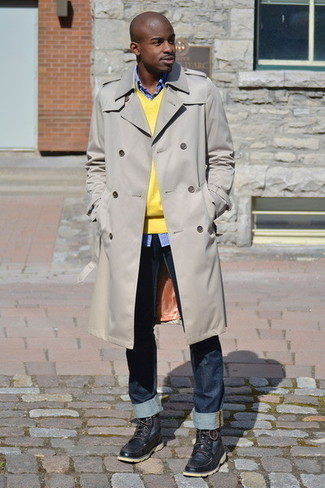 How to wear: navy jeans, blue gingham long sleeve shirt, yellow v-neck sweater, beige trenchcoat