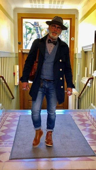 How to Wear a Dark Brown Wool Hat For Men: Dress in a black overcoat and a dark brown wool hat to create a casual and stylish look. Infuse some casualness into this look with tobacco leather work boots.