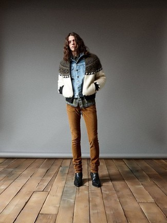 How to Wear a Light Blue Denim Jacket For Men: If you're planning for a fashion situation where comfort is top priority, this pairing of a light blue denim jacket and tobacco chinos is a no-brainer. If you need to instantly dress down your ensemble with a pair of shoes, why not add black leather cowboy boots to your look?