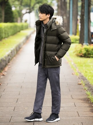 How to wear: grey chinos, grey long sleeve shirt, grey zip sweater, olive puffer jacket