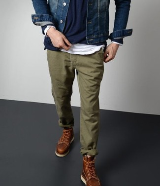 How to wear: olive chinos, white long sleeve t-shirt, navy crew-neck sweater, navy denim jacket
