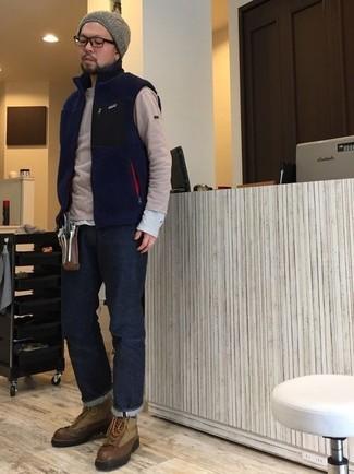 How to wear: navy jeans, grey long sleeve t-shirt, beige crew-neck sweater, navy fleece gilet
