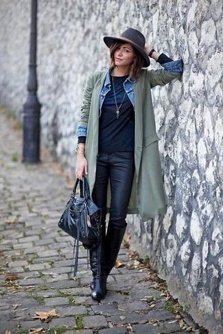 How to wear: black leather skinny jeans, black print long sleeve t-shirt, light blue denim jacket, olive lightweight trenchcoat