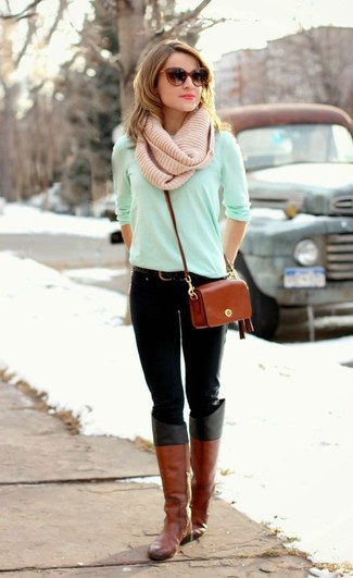 A mint long sleeve t-shirt and black jeans is a good combination worth integrating into your wardrobe. Tobacco leather knee high boots are a fitting option here. And if you're looking for an amazing transition outfit, this just might be it.