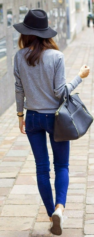 A grey long sleeve t-shirt and a hat are both versatile essentials that will give your outfits a subtle modification. For footwear go down the casual route with white low top sneakers. So as you can see, it's a seriously stylish, not to mention spring-appropriate, combo to keep in your transeasonal rotation.