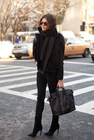How to wear: black skinny jeans, navy long sleeve t-shirt, black fur vest, black pea coat