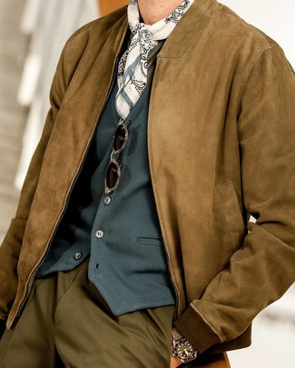 How to wear: olive dress pants, olive long sleeve t-shirt, teal waistcoat, brown suede bomber jacket