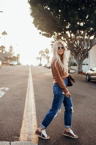 Women's Looks & Outfits: What To Wear In 2020: This casual combination of a brown crew-neck sweater and blue ripped boyfriend jeans is a goofproof option when you need to look stylish but have no extra time. A pair of brown suede low top sneakers instantly ups the style factor of any look.