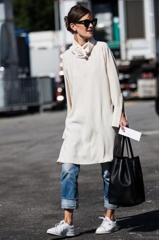 How to wear: black leather bucket bag, white leather low top sneakers, blue boyfriend jeans, beige sweater dress