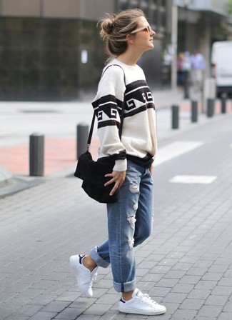 How to wear: black suede crossbody bag, white leather low top sneakers, blue ripped boyfriend jeans, white and black print sweatshirt