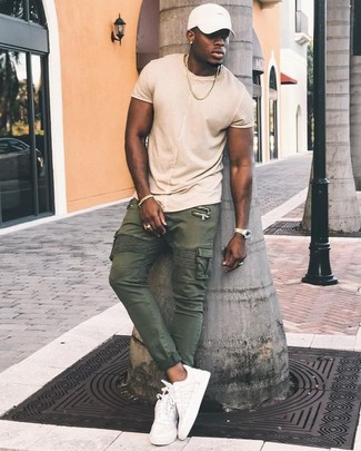 How to wear: white baseball cap, white leather low top sneakers, olive cargo pants, beige crew-neck t-shirt