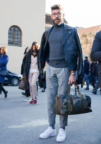 How to Wear a Duffle Bag For Men: Rock a black leather biker jacket with a duffle bag for a casual outfit with a twist. If you need to effortlessly smarten up this getup with a pair of shoes, why not introduce a pair of white leather low top sneakers to the mix?