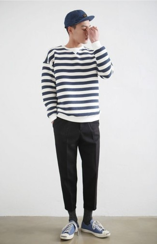 How to wear: navy baseball cap, blue canvas low top sneakers, black chinos, white and navy horizontal striped crew-neck sweater